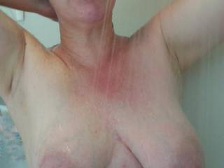 Washing her hair, heavy milk filled lactating breasts hanging out for your entertainment