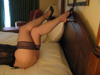 that is my favorite position when a woman is wearing sheer stockings and sexy heels like this.....you are a dream come true darlin!