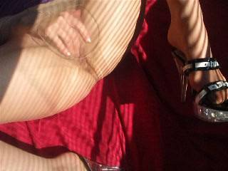 I feel so sexy with those high heels and the hot sun on my wet pussy. I know you guys love to see me masturbating this way.