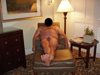 Weekend getaway at a luxury resort.  Hubby posing nude for me!  This chair made for some great sex over the weekend!