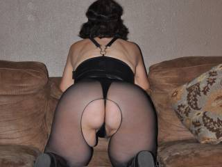 Nice view of my big, round ass. Crotchless hose and the costume has a snap for access. A fun night with Scotch and a nice cock.