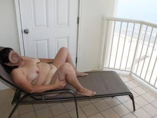 I am talking to the guys on the next balcony.  They can\'t see me and do not believe me that I am posing for nude pics!