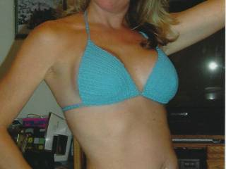 Here\'s my sexy wife doing a quick pose in one of her bikinis.  What do you think?