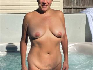 Just one more pic of Melissa enjoying the warm Fall weather....naked and in the hot tub!