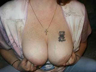 Here is my wife flashing here tits at me being a tease before our webcast show last night.
