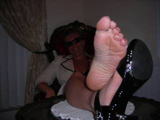 I'm thinking of how your feet would feel wrapped around my cock - I wish you could see how hard that thought makes me.