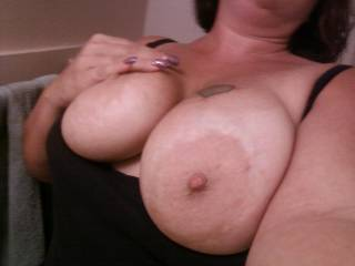 You´ve got so perfect big tits. I´d like to lick and suck these great nipples and areolas to make you moan. Then I would rub the hungry head of my big cock and finaly I give you a hot and creamy big load...