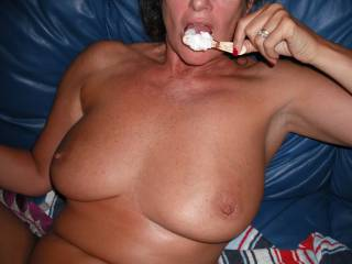 Teasing him with licking an icecream in a horny way. Afterwards he gave me such a good hard fucking and filled me up with his cumload.