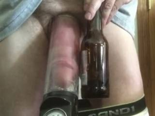 Pumping up my cock the size of a beer bottle