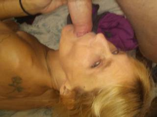 She looked up with her pretty eyes as she kissed and sucked and licked before we fucked hard doggystyle