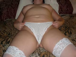 My hot wife wearing white stockings & white thong panties. Do you like thick girls?
