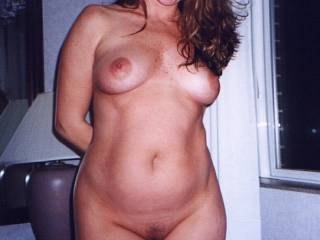 She looks like the girlfriend of a buddy of mine from the early 80's.  I wanted to fuck her so bad.  One time she bent over in front of me wearing a loose low-cut top and no bra.  When she stood back up she smiled and winked at me.  I almost saw her nipples.