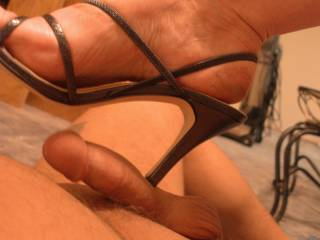Me pinning my husband's tiny little cock to his belly - the scream was loud as I pushed the heel in!!  His arse will be next!!  Emz xxx