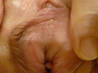 close up of  me holding my aching pussy open just before hubby stuck his hard cock deep inside her.