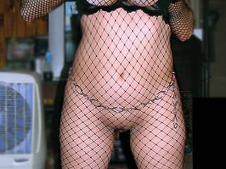 Just sharing another old shot of me in fishnets.  Hope you guys like it. Comments make me happy. Messages make me horny!  ;P xoxo Amy