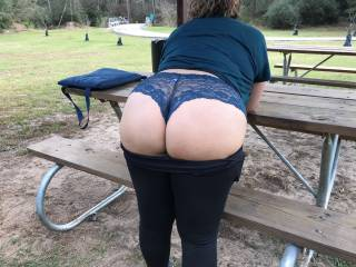 Flashing my ass in my blue lace panties at the public park for your pleasure. Notice the bike riders at the bridge to the left top of picture. A biker came from the other direction and caught me posing for this pic.