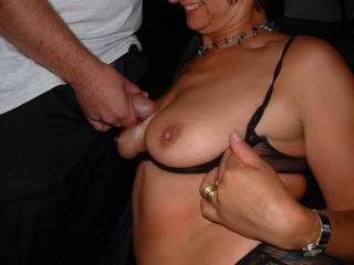 What lovely tits! Could I suck your nipples before I wank over you then cum on those tits?