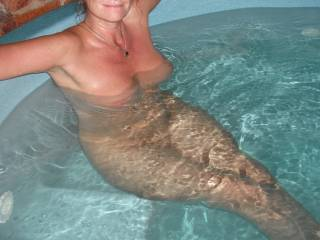 Relaxing in our spa at home after giving my Hubby a lovely long blowjob.  Big smile on my face, as I have the taste of my Hubbies cum still in my mouth after he shot a big load.