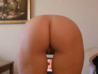 I would love to have that ass bent over in front of me. My cock is rock hard just from looking at the pic! Beautiful ass.