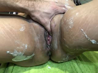 He touches her horny pussy after shaving. She gets so wet and horny and wants to get licked