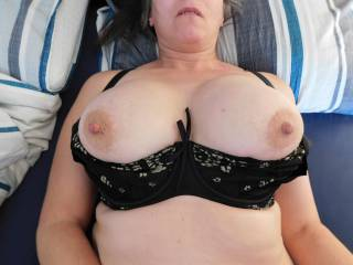 Having pulled my breasts from my bra.....