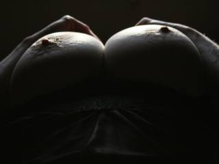 I really like this photo, the shadows on round breasts with nipples standing mmmmm such an erotic shot and a great view....