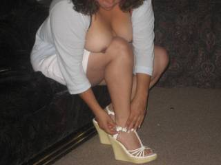 Beautiful tits and sexy heels too.  She's definitely looking hot and ready to fuck.
