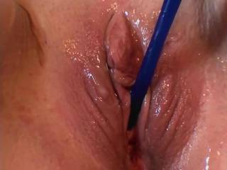 2 of 5 pictures of girlfriends wet, squirting pussy with a new style Silicone Sound in various stages of insertion. Is that one pretty pussy or what? Do you like the no hair look?  If you want to know how she stays so smooth without shaving just ask.