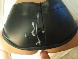Nice big load on her leather skirt