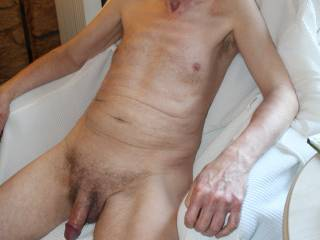 It appears that I am sitting back relaxing after you have drained me by the look of my cock.