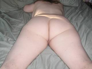 Naked, on a bed....ass facing up....that is HOT!