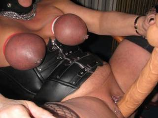 love those tits being tied off.....  turning colors with a nice large dildo