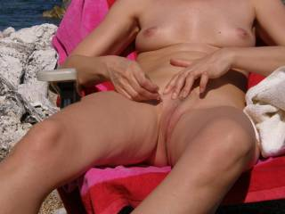 Taking care of her pussy outdoors