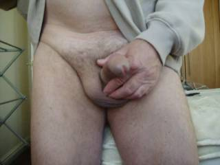oh yes, takind down those trousers to show your uncut then wanking back that skin, delicious
