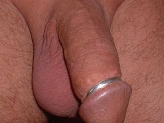 A silver cock ring given to Mr Oz by an admirer.  They had it custom made by a silversmith jeweller. They got the width, thickness and circumference just right, a good guess.  Feels great, especially wearing it during sex.