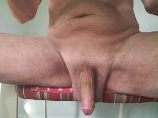This is an under table shot as I sit to spend time on Zoig. Would you like to get your mouth on my cock as it hangs there, or do you want to wait until it's hard?