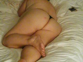 My beautiful wife\'s sexy ass and legs laying in bed waiting on me