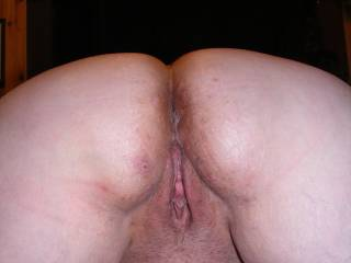 her bent over and waiting for a cum deposit