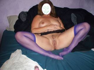 know that is what i call a real woman look at her in those purple stockings i just wish i could see more of those toes in those sexy purple stockings