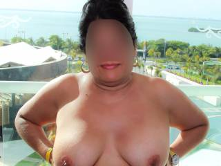 Strapless tops and vacation...titties come out often and easy!