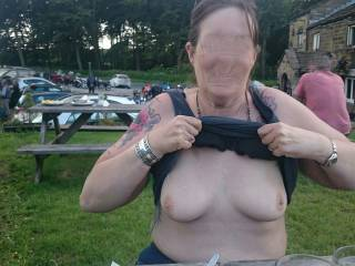 Re Edited to remove the faces of the people in the background. Mrs flashing outside our local on bike night.