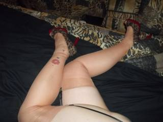 CUB LOVES IT WHEN I WEAR SEXY HIGH HEELS WITH GARTERS & STOCKINGS.