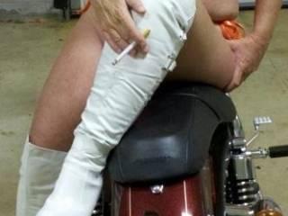 Nice boots, nice tits, nice Harley and a very sexy wife…u lucky fucker!
