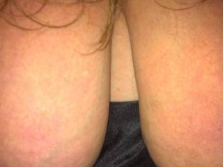 Pulled my GF tits out from her nighty.  Boy do they make my cock stiff