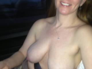 Those tits and that smile... You're beautiful and sexy as hell! How do you manage to get anything done ever? I'd figure the husband would have you on your back damn near 24-7! Very hot pic!!!