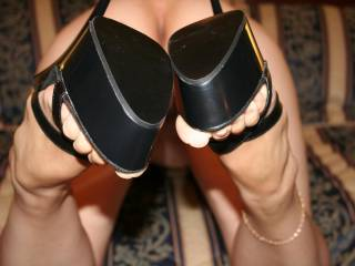 Let me stroke my cock between those amazing heels and feel your feet squeeze the cum out of me. Love this pic, gets me so hard.