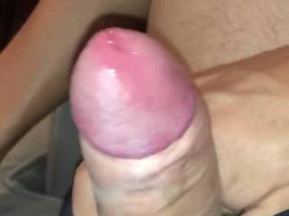 Early morning relaxing when I decided to stroke my uncut cock for a bit. Love watching the precum build up.
