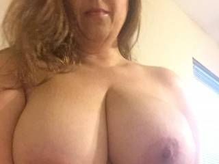 My hubby's favorite shot. Who wants to shoot their load all over my tits and face?