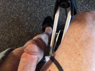 Riding my exercise bike with a stiff cock as I look at videos.