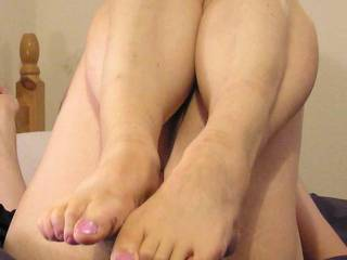 your toes,,, then the inside of your knees,,, and your thighs to get your legs spread nice and wide to kiss your pussy,,, and as the kissing turns to licking and sucking and fingering, i'd hold your feet together and fuck between your soles...  my girl will clean the cum from your toes while she sits on your face...